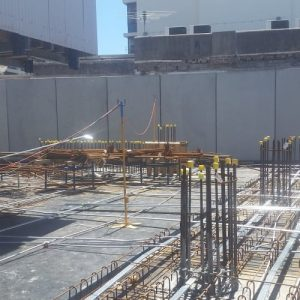 multiple lead stands on construction site